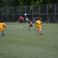 Мяч над головой.Детская футбольная команда «ОЛАКС».