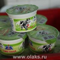 """Натуральный продукт - сметана , жирность - 20%, пластиковый стаканчик - 200 гр. Производство молочной продукции от """"Агрофирмы-Катынь""""."""